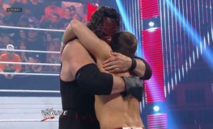 The tag team champions hug it out