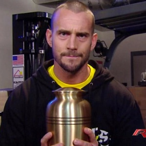 cm_punk_with_the_urn_by_undertakerzgurl-d5z89tf