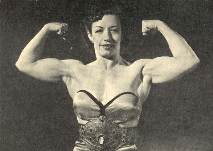 Mildred Burke flexing her muscles