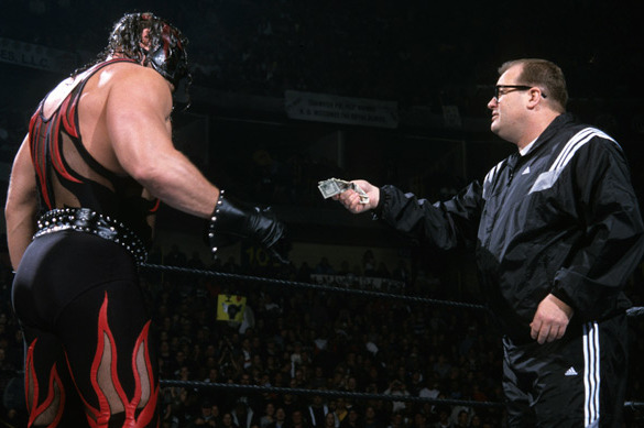 Drew is the guy in one of Shane McMahon's old tracksuits. Kane is the guy in the Kane costume