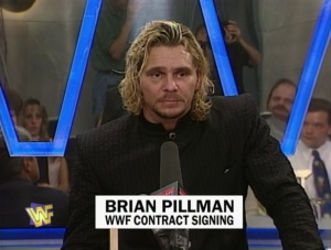 A delighted Brian Pillman makes his first official WWF appearance