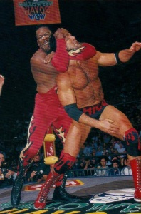 Booker T applying a sleeper hold is still more exciting than Stevie Ray after a hot tag